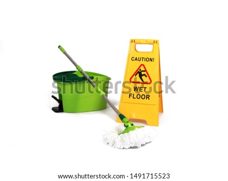 Yellow Caution slippery wet floor sign with mopp and bucket in the background - Safety sign cleaning service - isolated on white background