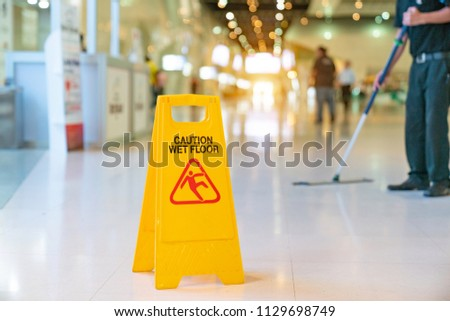 yellow caution wet floor sign