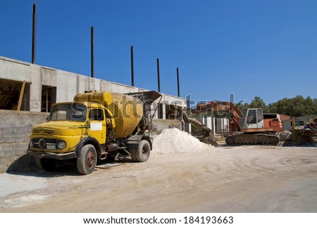 Yellow cement mixer truck and digger