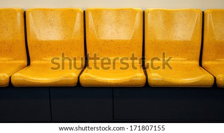 Yellow chair,chair in electric train