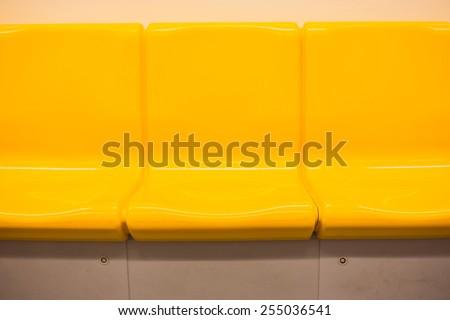 Yellow chair in electric train