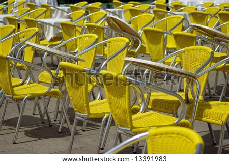 Yellow chairs in lines