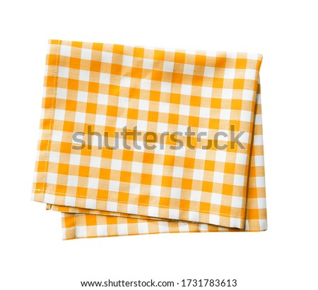 Yellow checkered folded cloth isolated,gingham checked kitchen towel,picnic decoration element. Stockfoto ©