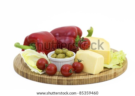 yellow cheese with fresh vegetables isolated on white background