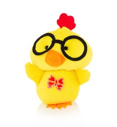 Yellow chicken plushie doll isolated on white background with shadow reflection. Plush stuffed puppet on white backdrop. Fluffy rooster toy with glasses for children. Cute furry plaything for kids.