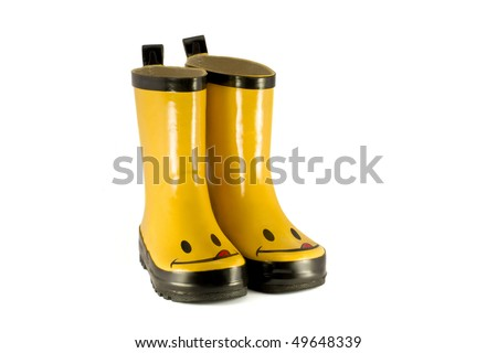 Yellow children`s boots isolated on white