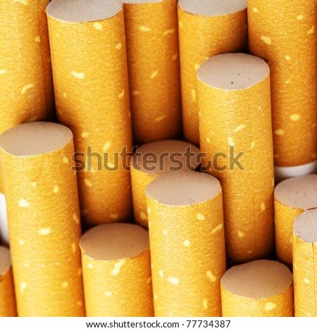 Yellow cigarette filters close-up, square cropping
