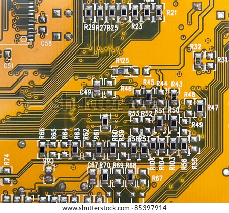 yellow circuit board with components.