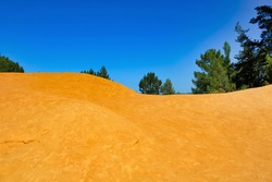 yellow clay and blue sky in a summer day, Roussillon France