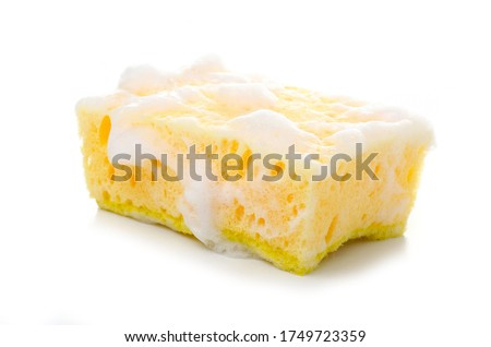 Yellow cleaning sponge in soap foam on white background isolation Foto stock ©