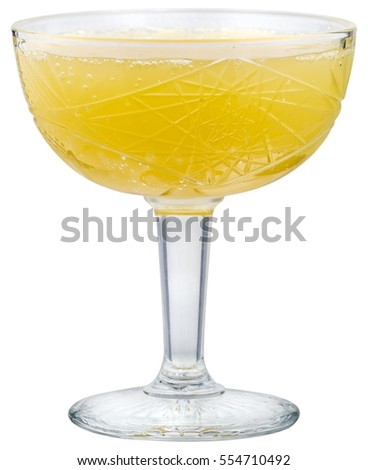 Yellow cocktail in champagne glass, isolated on white