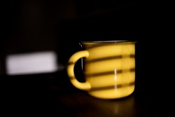 Yellow Coffee Cup With Shadow From Window.