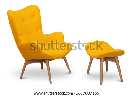 Yellow color armchair and small chair for legs. Modern designer armchair on white background. Textile armchair and chair. Series of furniture