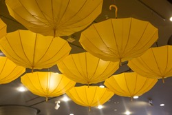 Yellow color umbrella hang upside down in ceiling