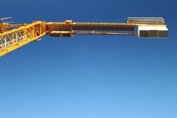 Yellow colored Crane with blue sky