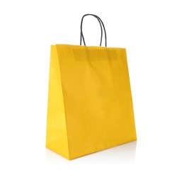 Yellow colour kraft paper gift bag with handle for easy carry. Cut out on white background. Eco & reusable shopping bag for groceries, gifts, goodies. Design template for Mock up, Branding, Advertise