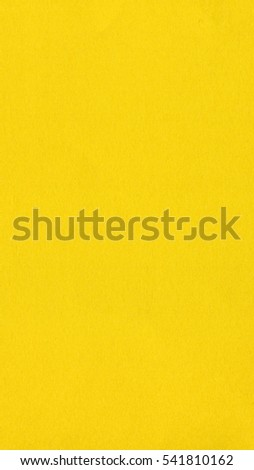 Yellow colour paper useful as a background - vertical - Shutterstock ID 541810162