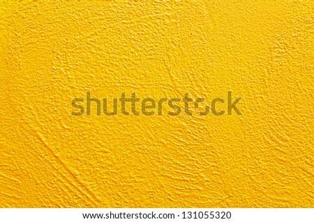 Yellow concrete rough wall.