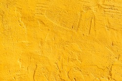 Yellow concrete wall background
