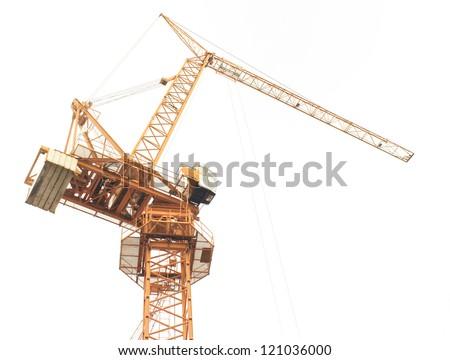 Yellow construction crane isolated on white background