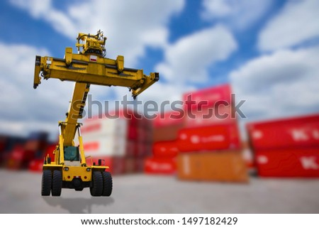 Yellow container handlers With a background as a container warehouse