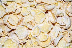 Yellow corn flakes for designer background.