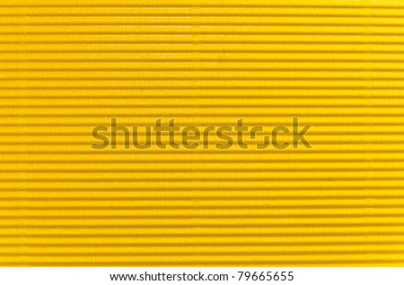 yellow corrugated cardboard texture. Closeup.