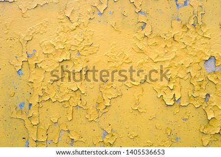 yellow cracked paint damaged concrete rough texture  Stock photo ©
