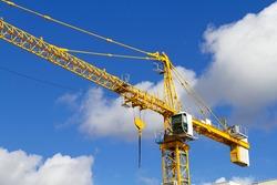 yellow crane against a blue sky