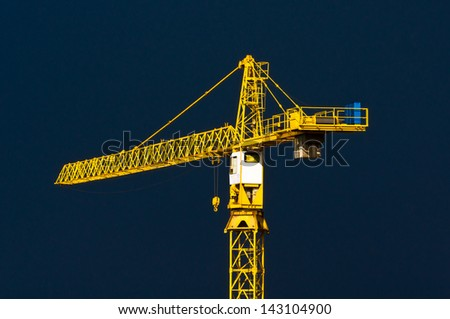 Yellow crane with a blue sky background after the rain