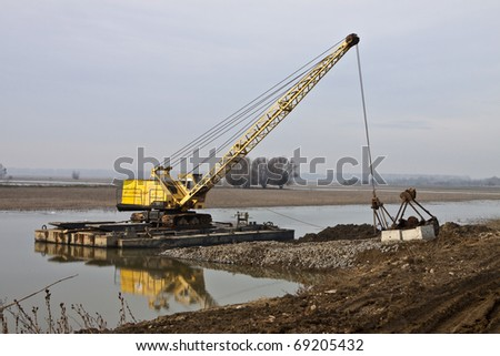 yellow crane with risen telescopic boom