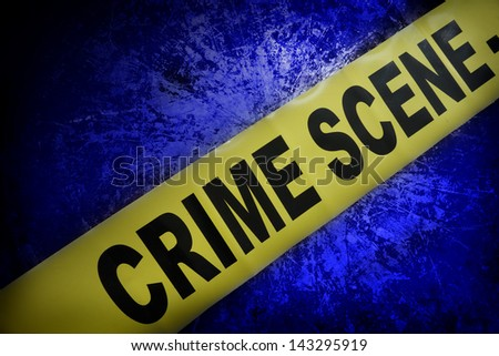 yellow crime scene tape on blue textured background