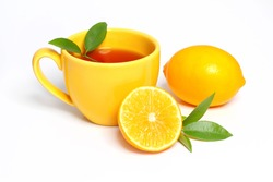 yellow cup tea and a piece lemon on white background