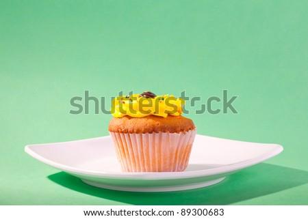 Yellow Cupcake - stock photo