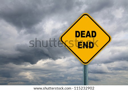 Yellow dead end road sign on a cloudy sky background