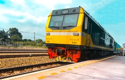 Yellow diesel locomotive train stop at public station. Vintage style of Train Yellow Diesel electric Locomotives. Yellow train, Thailand train,