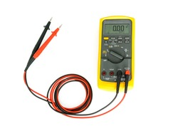 Yellow Digital multimeter with probes on white background , A multimeter is an electronic measuring instrument.