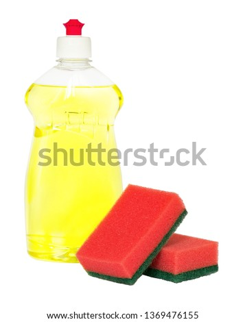 Yellow dishwashing liquid in transparent plastic bottle and two red foam sponges isolated on white background. Kitchen detergent. Household chemicals. Household chores. #1369476155