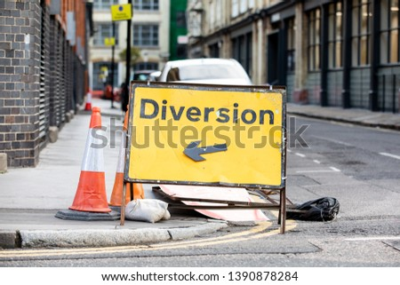 Yellow diversion road sign in a UK city street #1390878284