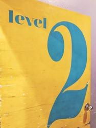 Yellow door with number 2