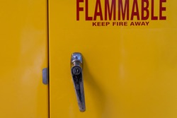 Yellow doors of a flammable safety cabinet used to keep flammable dangerous product