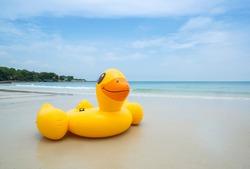 Yellow Duck Swim rings on the beautiful beach