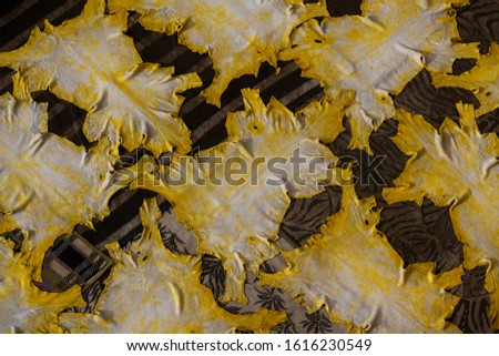 Yellow dyed animal skins laid out to dry in the tanneries in Fez, Morocco.  Original artisan craft.