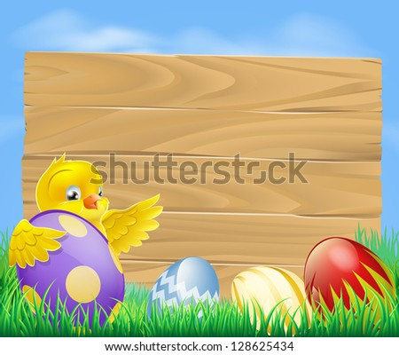Yellow Easter chicken and chocolate painted Easter eggs with a blank wooden sign for your message