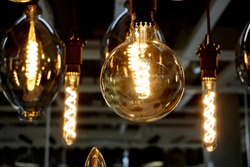 Yellow Electric bulbs in Retro style closeup. Faraday lamp