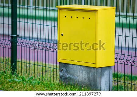 Yellow electric control box outdoor. Urban power and energy. Supply electricity.