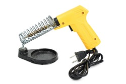 Yellow electrical solder on soldering iron stand isolated on a white background with clipping path.