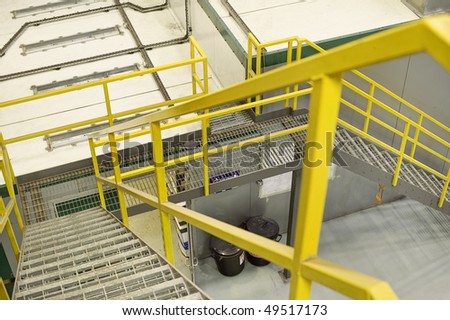 yellow emergancy exit staircase in a factory
