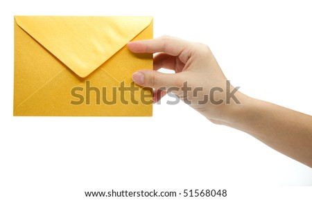 yellow envelope in the hand isolated on white background