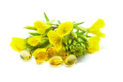 Yellow evening primrose (Oenothera biennis) flowers and capsules with oil, cosmetics and natural remedies for sensitive skin and eczema, isolated on a white background